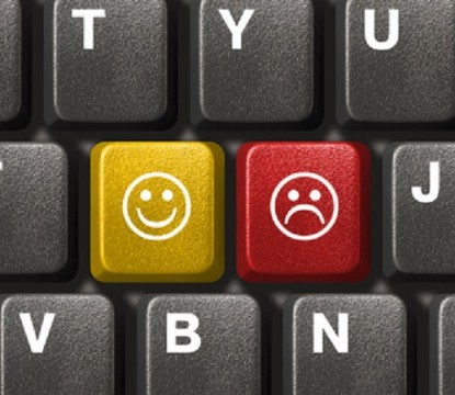 Computer keyboard close-up with two smiley keys (emoticons)